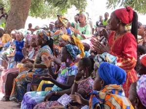 Women sing and share at an inter-village meeting in Senegal.